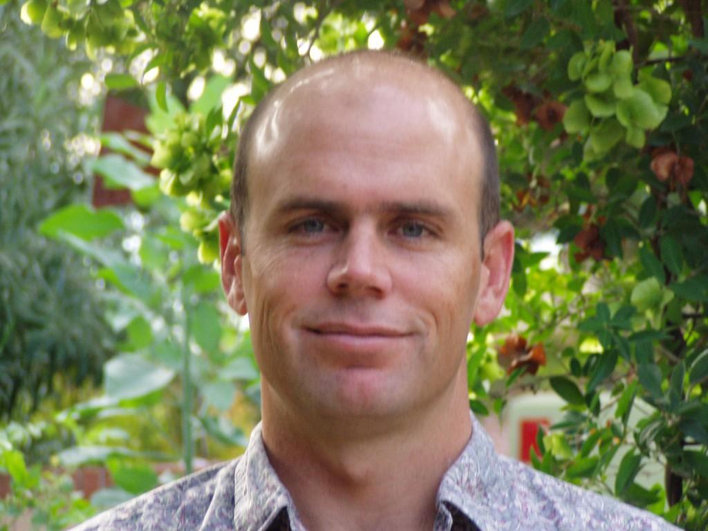 Travis E. Huxman