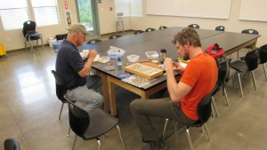 Researchers collecting and inventorying moths