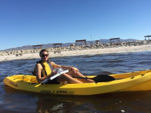 student in canoe